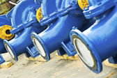 Blue water pumps — Stock Photo