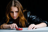 Hot girl playing with a model of the red sport car. — Stock Photo