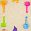 Stock Photo: PLASTIC TOYS ON SAND