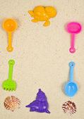PLASTIC TOYS ON SAND — Stock Photo