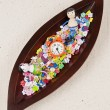 Stok fotoğraf: Children doll in wooden leaf tray