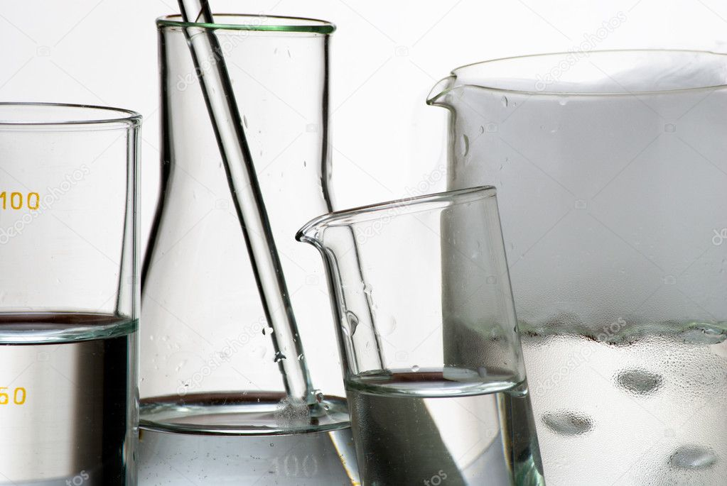 Laboratory glassware during experiment and vapors over liquid — Stock Photo #3777288
