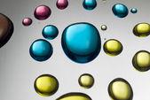 Zamknąć w kolorowe krople cieczy — Zdjęcie stockowe
