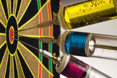 Target and three syringes with colourful liquid — Stock Photo