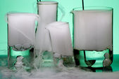 Laboratory glassware during experiment with erupted vapors — Stock Photo