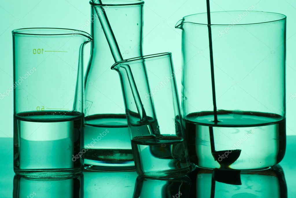 Assorted laboratory glassware filled with liquid — Stock Photo #3848318
