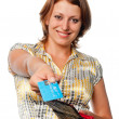 Smiling girl with a purse and credit card in hands — Stock Photo