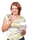 Smiling young businesswoman with pen and calculator — Stock Photo