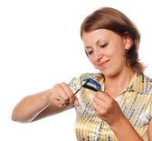 Girl cuts a credit card, refusal of crediting — Stock Photo