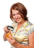 Girl considers a hamburger through a magnifier — Stock Photo