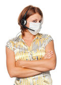 Girl in a medical mask and ear-phones with a microphone — Stock Photo