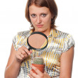 Girl considers a cactus through a magnifier — Stock Photo