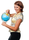 Smiling girl shows on the globe — Stock Photo