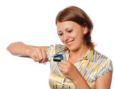 Smiling girl cuts a credit card, refusal of crediting — Stock Photo