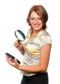 Smiling girl considers hard driver through a magnifier — Stock Photo