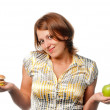 Stock Photo: Girl is chosen between apple and hamburger