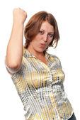 Girl shakes the fist lifted upwards — Stock Photo