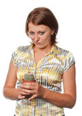 Dissatisfied girl with a cactus — Stock Photo