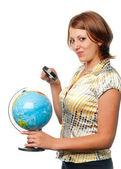 Girl examines the globe through a magnifier — Stock Photo