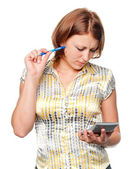 Young businesswoman with pen and calculator — Stock Photo