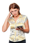 Anxious girl with the calculator — Stock Photo