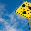 Recycle symbol on traffic sign. - Stock Photo