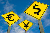 Euro, yen and dollar symbols on road sign. — Stock Photo