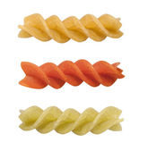 Uncooked pasta fusilli in different colours, isolated, clipping — Stock Photo
