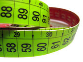 Measuring tape on white — Stock Photo