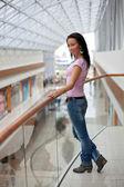 Beautiful brunette on a balcony — Stock Photo