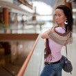 Girl with a scarf over mall background — Stock Photo
