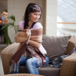 Pretty brunette is playing with a scarf - Stock Photo