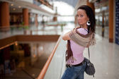 Girl with a scarf over mall background — Stockfoto