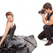 Young adult female Caucasian model being photographed in studio — Stock Photo
