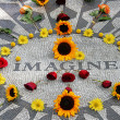 Imagine mosaic, full of flowers, in Central Park - Stock Photo