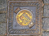 Manhole cover in Prague — Stock Photo
