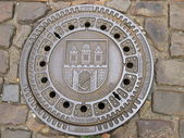 Manhole cover in the Czech — Stock Photo