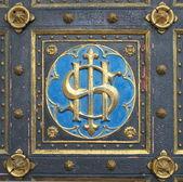 Emblem on the doors of church — Stock Photo