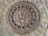 Manhole cover in the Czech Krumlov — Stock Photo
