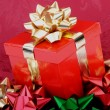 Red Christmas Gift Box Gold Ribbon Colorful Bows — Stock Photo #3838553