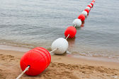 Buoy on the beach — Stock Photo