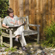 Woman on a small bench — Stock Photo #3841595