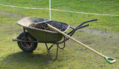 Wheelbarrow with manure — Stock Photo
