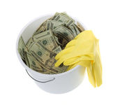 Twenty Dollar Bills in White Cleaning Bucket with latex gloves — Stock Photo
