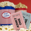 Movie stubs and popcorn - Stock Photo