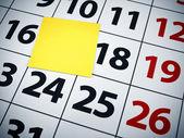 Blank sticky note on a calendar — Stock Photo