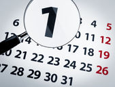 Magnifying glass on a calendar — Stock Photo