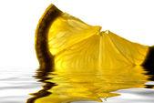 Lemon Wedge In Water — Stock Photo