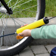 Pumping bicycle tire — Stock Photo