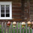 Stock Photo: Rural house and old jugs